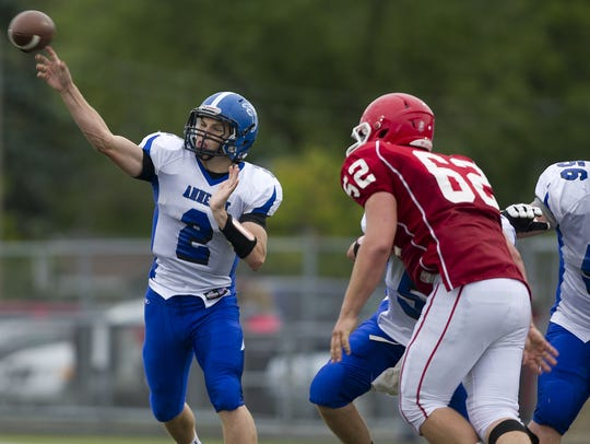 Amherst graduate Garrett Groshek, who led the Falcons to a Division 5 state championship in November and earned all-state honors as a senior, got a chance to play quarterback as a freshman walk-on at the University of Wisconsin.