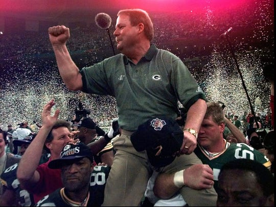 Mike Holmgren being carried off the field.