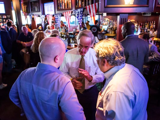 Sen. Tom Carper talks with guests during a dinner between members of the Delaware Democratic National Convention delegation and business leaders and lobbyists at Chickie's and Pete's outside the Democratic National Convention in Philadelphia on Wednesday evening.