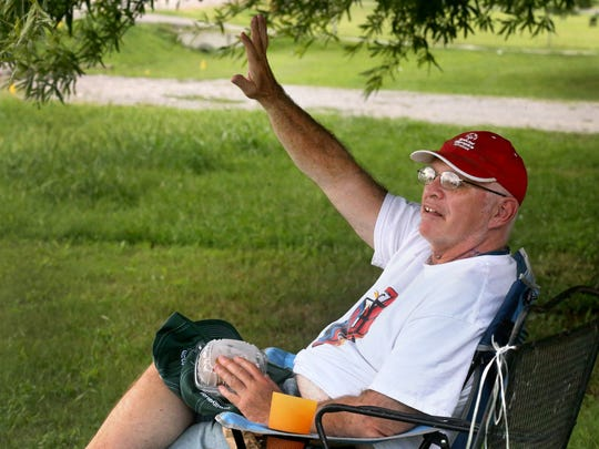 Paul Tidwell, the waving guy, waves at cars from his front yard, on Monday, Aug. 22, 2016, despite being diagnosed with stage 4 lung cancer.