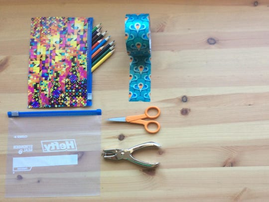 Make your own zipper pouch out of duct tape and a zipper bag.