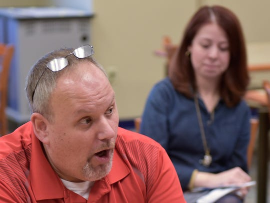 Teacher Sean Wible talks about the IB program at CASHS as Jennifer Michael looks on during a meeting Friday, Oct. 14, 2016.  Chambersburg is an International Baccalaureate (IB) School.
