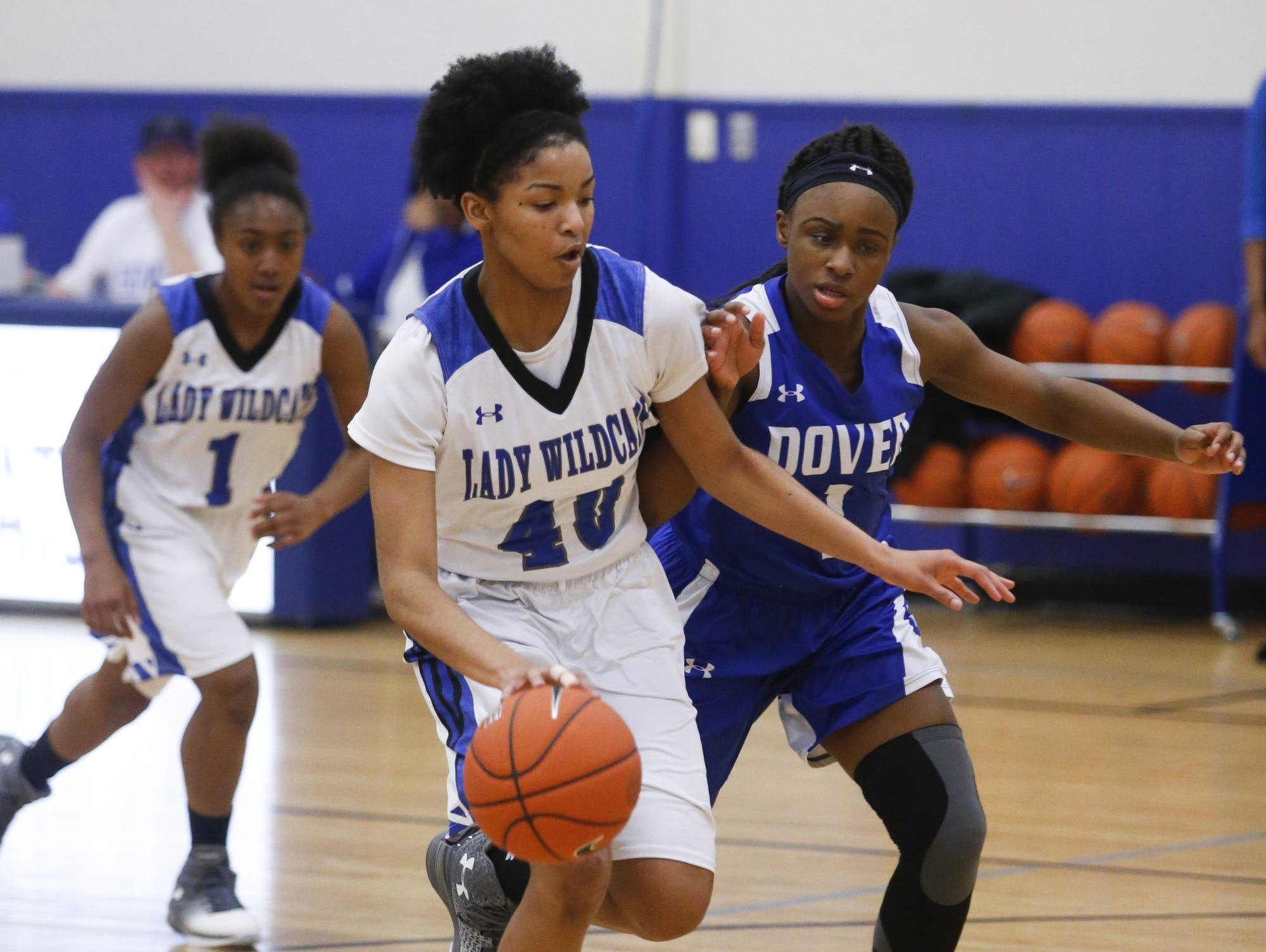 Howard's Ronnasia Blatch-Huggins (40) moves for the basket against Dover's Jacarra Jackson in Howard's opening round win in the DIAA state high school tournament Tuesday at Howard.