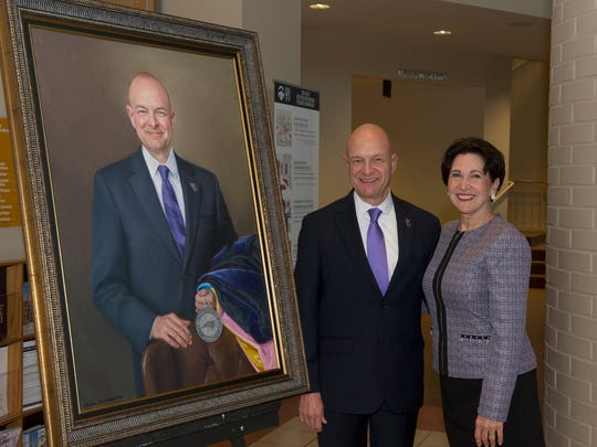 Western Carolina University Chancellor David O. Belcher and first lady Susan Belcher take a look at his portrait, painted by Virginia artist Steve Craighead.