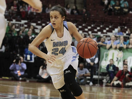 Gabbie Marshall of Mount Notre Dame drives the lane.  Cincinnati Mount Notre Dame takes on Toledo Notre Dame Academy in the Division I State Championship Saturday Night, March 18, 2017 in Columbus.