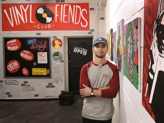 Los Angeles-based artist Diego Arturo Mendoza stands with his work June 29 at The Dream Chasers Club in Downtown El Paso. Mendoza opened his exhibit in conjunction with the Last Thursdays El Paso Gallery Crawl and Art Market.