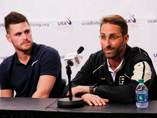 Olympic gold medalist diver and former Purdue standout David Boudia, left, listens as his coach Adam Soldati comments after Boudia's announcement that he will continue training with the goal of the Tokyo Olympic in 2020 during a press conference Tuesday, September 12, 2017, on the campus of Purdue University.
