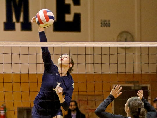 Notre Dame's Reagan Macha spikes the ball in the match