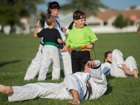 Second-grader Von Kleiv, 7, performs during a karate