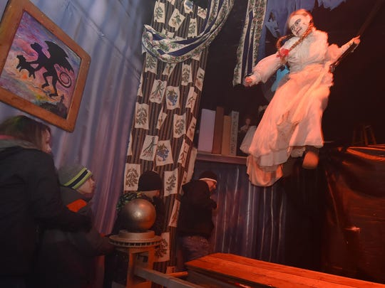 "Gretchen Mueller appears to fly through the air as ""Annabel'' inside the Haunted Mansion at Quietwoods South Camping Resort, 9425 Lovers Lane, Brussels. To see more photos and a video, go to: www.doorcountyadvocate.com."