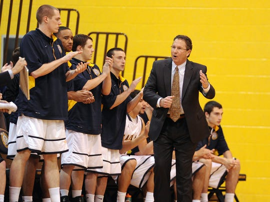 Marian University head basketball coach Todd Lickliter walks the bench during the game against Bethel College inside the Physical Education Center, January 11, 2014, in Indianapolis. Twenty-fourth ranked Marian University defeated fourth ranked Bethel College 77-70.
