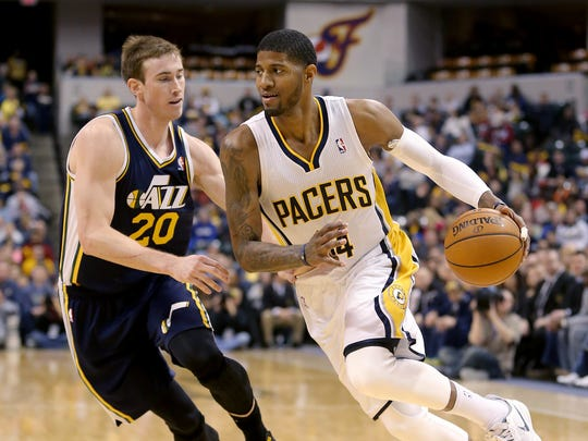 Pacers Paul George drives on Jazz F Gordon Hayward,left, in the second half of their game  March 2, 2014, evening at Bankers Life Fieldhouse.