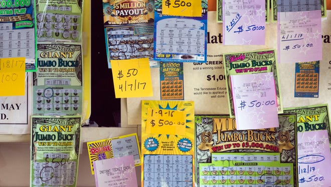 Winning scratch-off tickets are proudly displayed at Gap Creek Market & Deli. The store recently sold a $50,000 Powerball ticket.