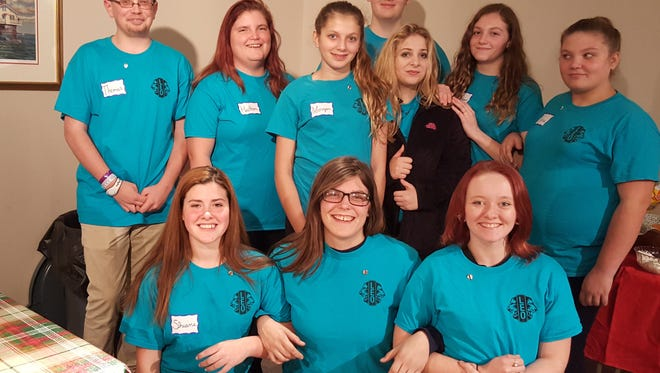 Members of the newly chartered Deal Island Chance Leo Club are, in front from left, Shiane Miller, assistant secretary; Caitlyn Bauer, treasurer; and Carlie Daniels, vice president. Standing from left are Thomas Miller, president; Heather Miller; Morgan Brenner, assistant treasurer' Makayla Brenner; Jordan Brenner, secretary; and Kara Burr, vice president. In back is Aaron Hastings.