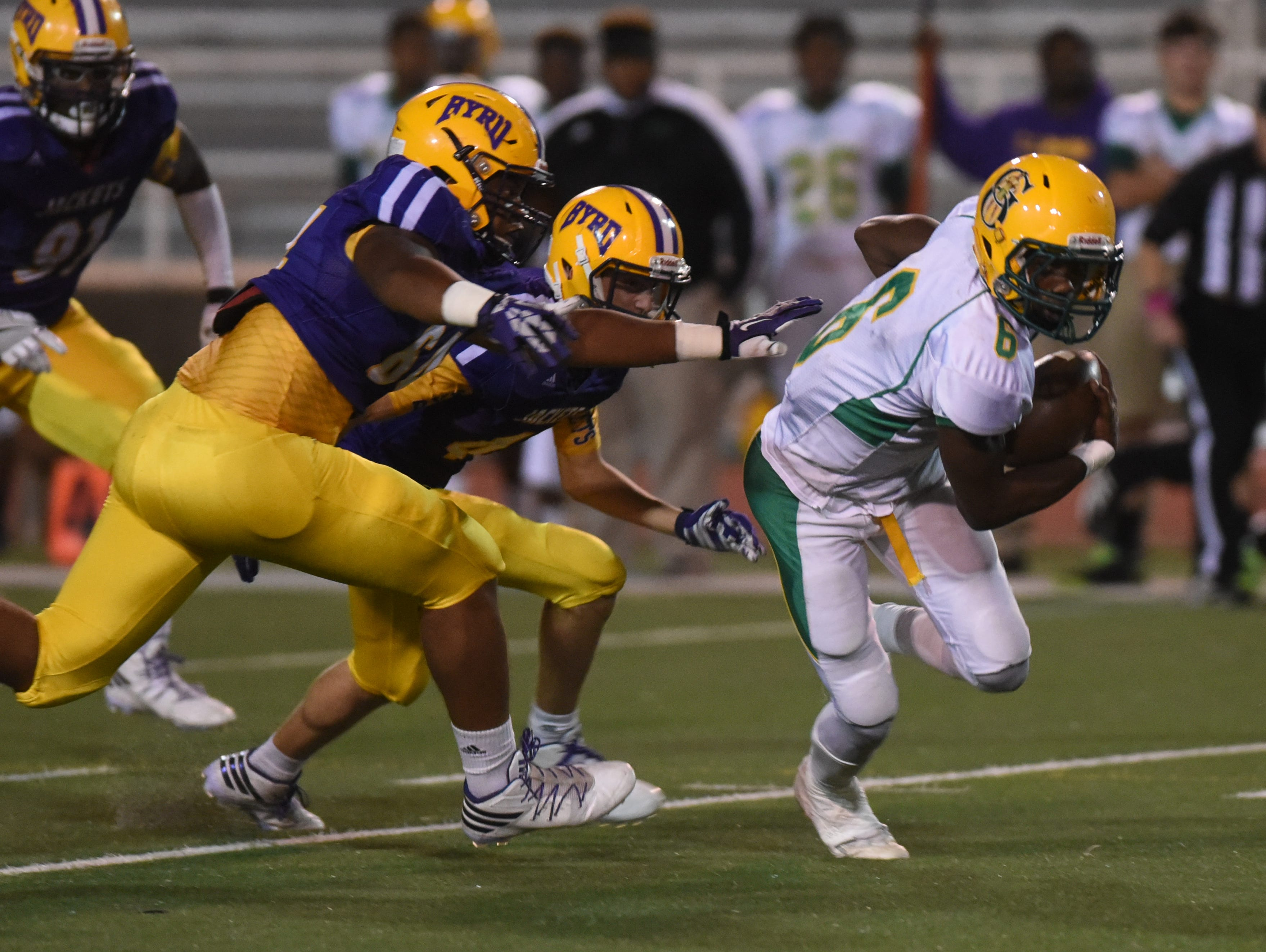 C.E. Byrd chases down Zelanz French for a loss after he miss handles the ball behind the line of scrimmage.