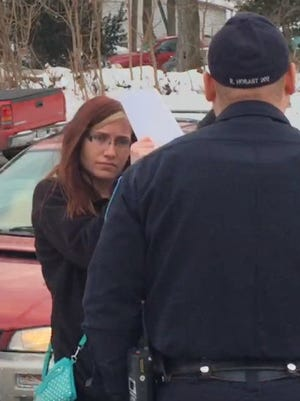 Katlin Wolfert talks to Kingston police outside of the Ulster County Family Court, after her family called authorities last week.