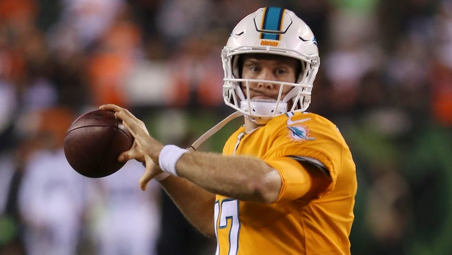 Miami Dolphins quarterback Ryan Tannehill (17) warms up prior to the game against the Cincinnati Bengals  at Paul Brown Stadium.