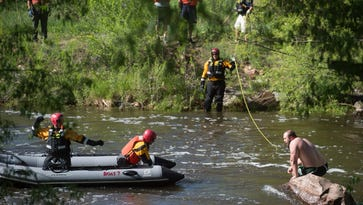 Man gets rescued from Fort Collins river by Poudre Fire Authority, Larimer County Dive Rescue