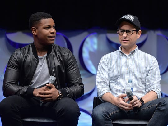 "J.J. Abrams (right, with John Boyega) returns to the Star Wars Celebration stage as director of ""Episode IX."""