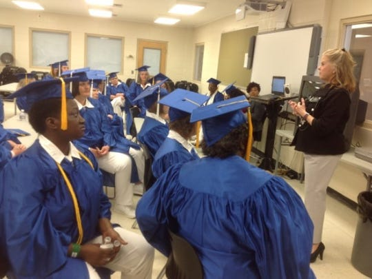 Former Alabama Supreme Court Chief Justice Sue Bell Cobb talks with Ingram State Technical College graduates before the start of commencement ceremonies May 15. Cobb was the days' featured speaker, encouraging graduates to take full advantage of life's second chances as they move past incarceration into their future lives.