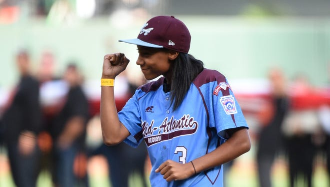 Little League player Mo'ne Davis reacts after throwing out the ceremonial first pitch before game four of the 2014 World Series between the San Francisco Giants and the Kansas City Royals at AT&T Park.