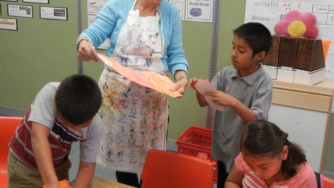 Jennifer Gimzewski teaches students at Scott Elementary School as part of Salem Art Association's educational programming in local schools. The association received a $5,000 grant to support such programming from the PGE Foundation.