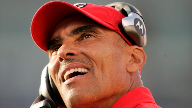 Herm Edwards, then-Kansas City Chiefs head coach, watches an NFL football game in Oakland, on Nov. 30.
