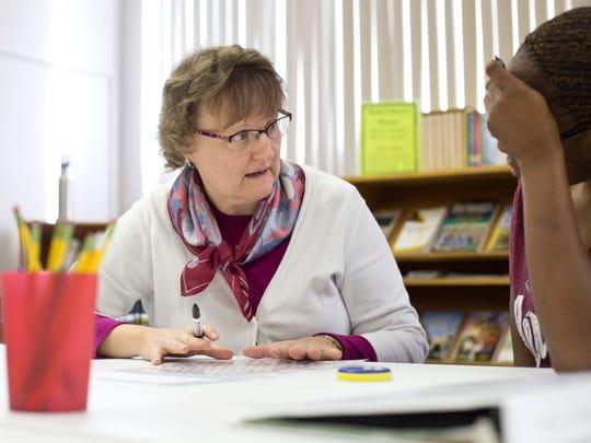 Tutor Martha Drake works with a student on math skills