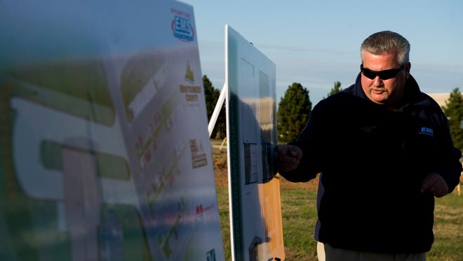 EMS Chief Jimmie Edwards presents layouts for the new Emergency Medical Services administrative and logistics center next to Tennova Healthcare during a groundbreaking ceremony Oct. 30, 2017.