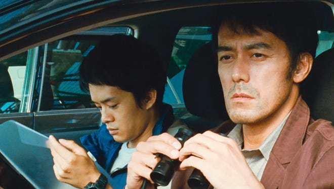 """Detectives Ryota (Hiroshi Abe) (right) and his partner (Sosuke Ikematsu) spy on Ryota's wife in After the Storm."""""""