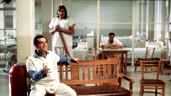 "Jack Nicholson (front) leads a crew of disorderly mental patients in ""One Flew Over the Cuckoo's Nest."""