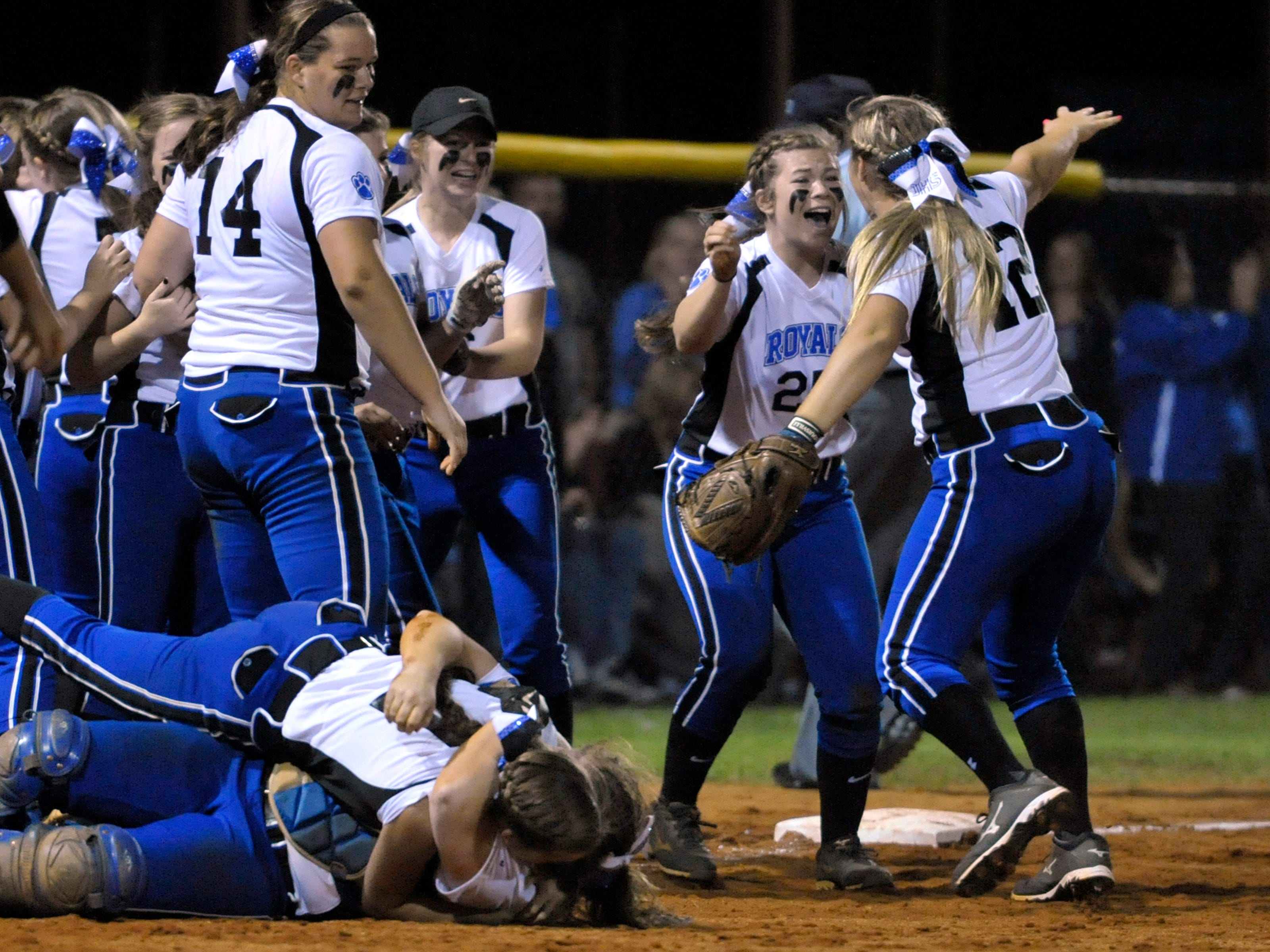 The Jay Lady Royals celebrate their 2-1 Region 2-1A softball victory over the Chipley Tigers moments after getting the final out on Chipley and putting and end to a Tigers rally that threatened to turn the game around for Chipley.