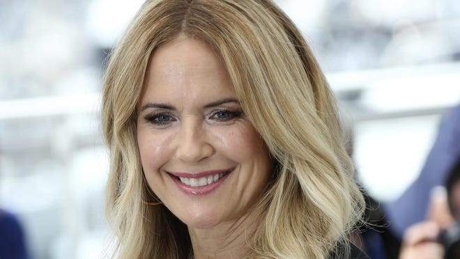 """FILE - In this May 15, 2018, file photo, actress Kelly Preston poses for photographers during a photo call for the film 'Gotti' at the 71st international film festival, Cannes, southern France.  Actress Kelly Preston, whose credits included the films """"Twins"""" and """"Jerry Maguire,"""" died Sunday, July 12, 2020, her husband John Travolta said. She was 57."""
