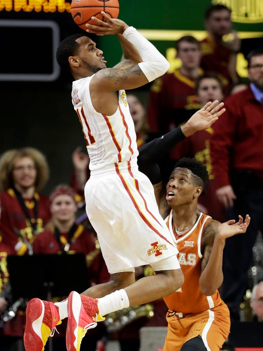 Iowa State guard Monte Morris shoots over Texas guard Kerwin Roach Jr., right, during the first half of an NCAA college basketball game, Saturday, Jan. 7, 2017, in Ames, Iowa. (AP Photo/Charlie Neibergall)