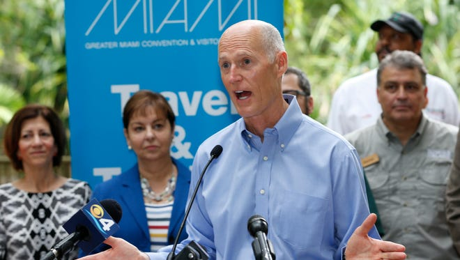 """Florida Gov. Rick Scott speaks during a news conference at Jungle Island zoological park June 13, 2017, in Miami. Scott spoke in Miami as part of his """"Fighting for Florida's Future Victory"""" tour. Gov. Scott professes uncertainty when it comes to climate change data. When pressed for an opinion, the governor once famously replied, """"I'm not a scientist."""""""