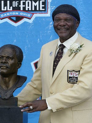 Carl Eller poses with his bust after his induction into the Pro Football Hall of Fame, Sunday, Aug. 8, 2004, in Canton, Ohio. Eller, a former Viking, is part of the SoberBowl event held the day of the Super Bowl in Minneapolis.