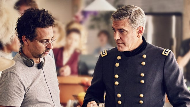 George Clooney, right, receives direction from Grant Heslov while shooting the Nespresso commercial.