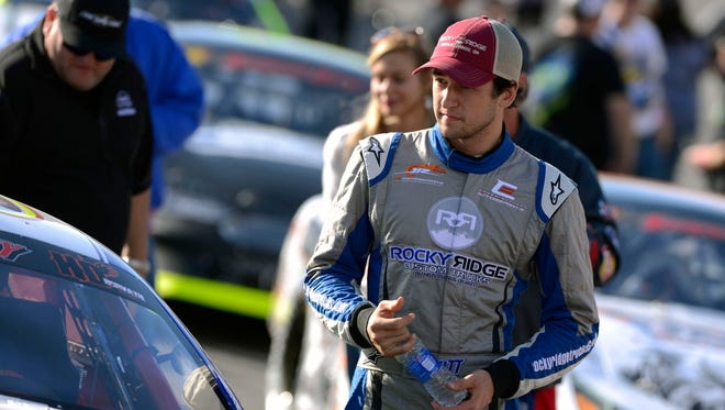 Chase Elliott makes his way to his car Sunday during the 48th annual Snowball Derby at Five Flags Speedway.