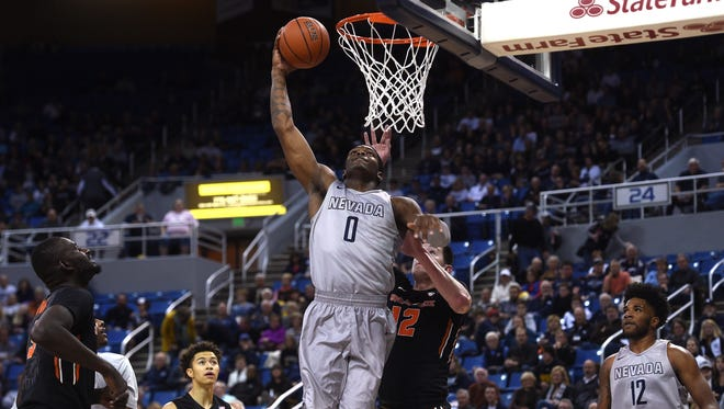 Nevada's Cameron Oliver dunks against Oregon State's Drew Eubanks during their game Friday.