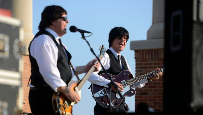 The Not Quite Fab: A Tribute to the Beatles, perform for the crowd Sunday, August 20, 2017 during the 2017 Blues Angel Music Blues on the Bay Summer Concert Series at Community Maritime Park.