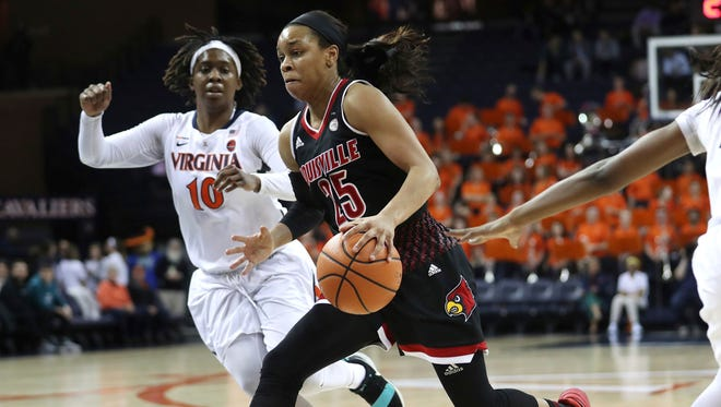 Louisville's Asia Durr (25) splits two Virginia defenders during the first half of an NCAA college basketball game Thursday, Feb. 1, 2018, in Charlottesville, Va.