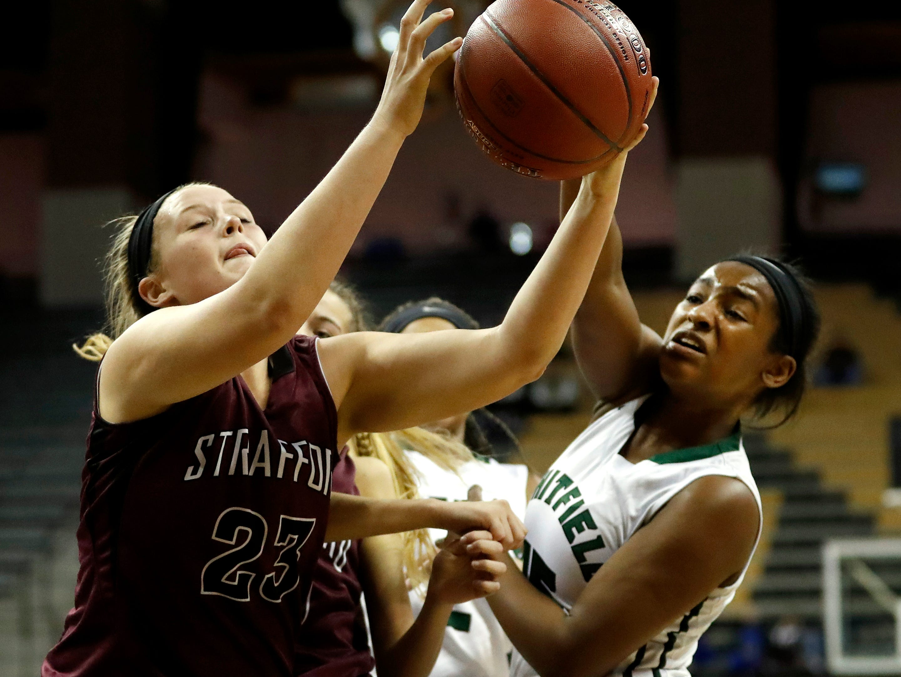 Strafford's Zoey Mullings, left, and Whitfield's Nia Griffin reach for a rebound during the first half of the Missouri Class 3 girls high school championship basketball game Saturday, March 11, 2017, in Columbia, Mo.