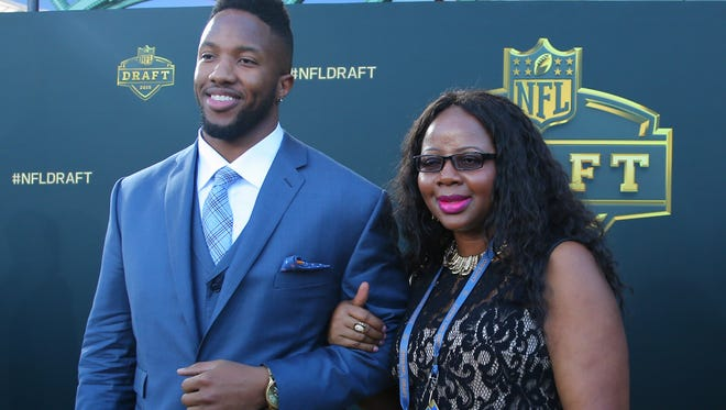 Cedric Ogbuehi (Texas A&M) and Kelly Ogbuehi arrive on the gold carpet before the first round of the 2015 NFL Draft at the Auditorium Theatre of Roosevelt University.