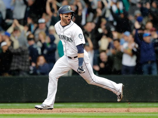 Seattle Mariners' Mitch Haniger celebrates as he runs