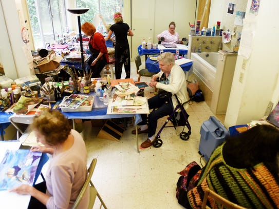 Artist Jerry Wray has an art studio at her house where