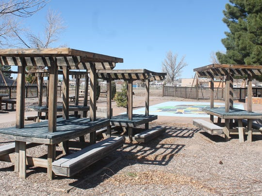 Clusters of wooden picnic tables were untouched by the fire that decimated the wooden playscape in September.