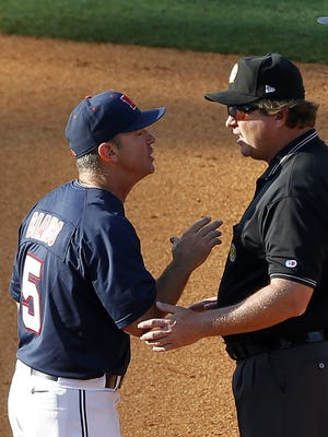 Mississippi coach Mike Bianco argues with umpire Scott Erby after a call during the ninth inning at the Southeastern Conference NCAA college baseball tournament, against Arkansas on  Friday, May 23, 2014, in Hoover, Ala. (AP Photo/Butch Dill)