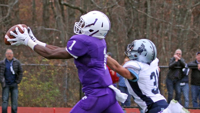 New Rochelle's Rashon McNeil hauls in a pass and beats John Jay East Fishkill's Skyler Smith for a 56-yard touchdown during the Section 1 Class AA championship game at Yorktown High School Nov. 7, 2015. New Rochelle defeated John Jay East Fishkill 44-25.