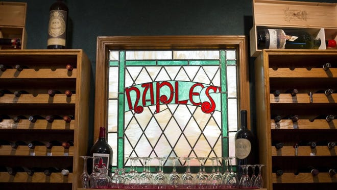 A stained-glass sign is the centerpiece at Naples Italian Restaurant's bar.
