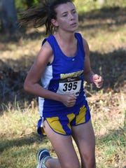 Mountain Home's Rebecca McGough competes in the senior girls' race of the Bomber Invitational on Tuesday. McGough placed third overall for the Lady Bombers.